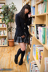 Kasugano Yui Standing Beside Book Shelf In Uniform