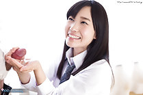 Kasugano Yui on her knees long hair big smile holding spent cock cum in her hand