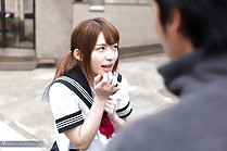 Kogal talking to man in street wearing uniform