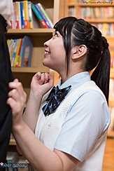 Student On Her Knees In Library In Uniform Looking Up