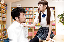 Atomi Shuri in pigtails giving footjob with bare feet in library