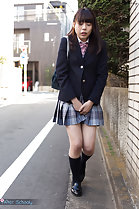 Student walking outdoors in uniform