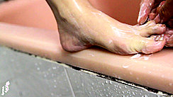 Soaping Bare Foot And Toes