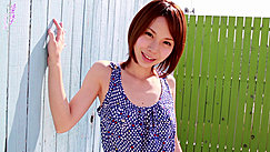Ryouko Leaning Against Painted Fence Wearing Blue Dotted Top Short Hair