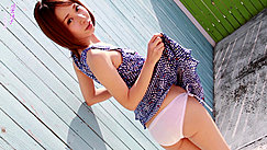 Looking Over Her Shoulder Raising Hem Of Dress In White Panties