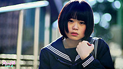 Minori Holding Onto Strap Short Hair