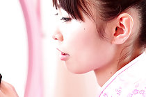 Minami H strips pink cheogsam at her dressing table
