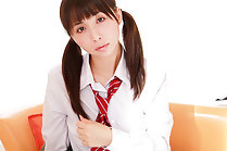 Shaved kogal in pigtails Elly strips uniform on couch