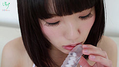 Head Of Vibrator Held To Her Lips Teasing Tip With Her Fingertips