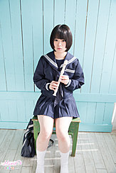 Kogal Seated On Chair Wearing Uniform Holding Recorder