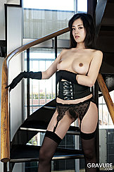 Her Arm Folded Under Her Chest Japanese Girl Konata Suzumiya In Black Stockings Pussy Hair Peeping Out