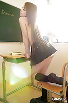 Resting topless on school desk standing topless long hair down her back to pleated skirt wearing socks and shoes