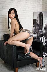 Kneeling On Chair Long Hair Down Her Back Wearing Camo Knickers In High Heels