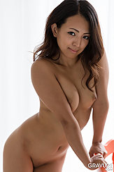 Leaning Naked Against Chair Long Hair Small Breasts Shaved Pussy