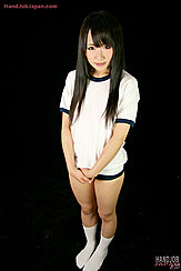 Standing In Uniform Long Hair Flowing Down Over Her Shoulders Hands Clasped Together In White Socks