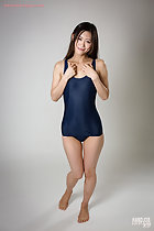 Wearing swimsuit long hair hands raised her feet bare