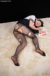 Kogal Kawagoe Yui Lying On Her Side Holding Sex Toy Wearing Torn Pantyhose