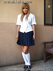 Standing Beside Wall Wearing Student Uniform Blonde Hair Down To Her Chest