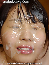 Yui with her face drenched in bukkake cum