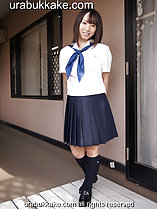 Standing outside home wearing seifuku uniform hands behind her back