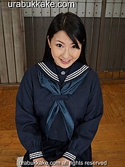 Kogal Seated In Uniform Hands On Her Laps